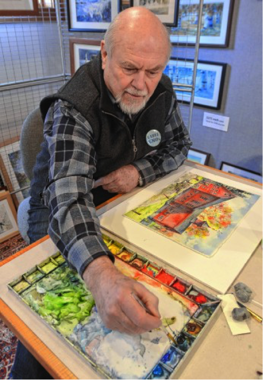 Walter Cudnohufsky works on a painting of the William Cullen Bryant Homestead barn at his studio in Ashfield, Friday, March 18.