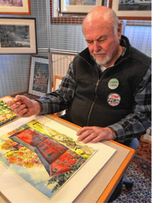 Walter Cudnohufsky pauses while working on a painting of the William Cullen Bryant Homestead barn at his studio in Ashfield, Friday, March 18.